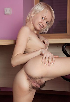 Horny blonde haired nympho Margarita strips off out of her sweats and gapes her pretty pink pussy on the desk chair.